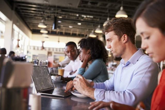 business-people-working-at-counter-in-coffee-shop-PL39KDL-1